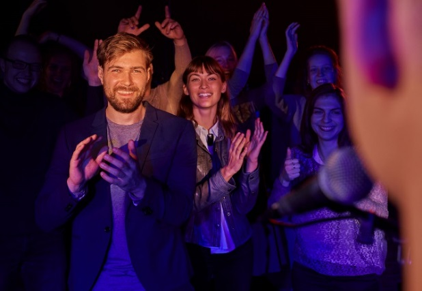 Man and Women clapping at a show